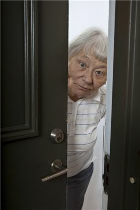 elderly woman opening door